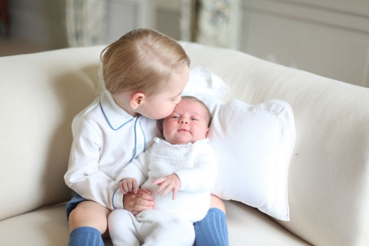 Prince George with Princess Charlotte in a photo taken by the Duchess of Cambridge in 2015.