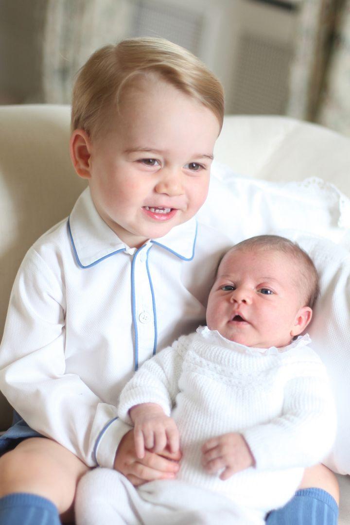 Prince George with Princess Charlotte.