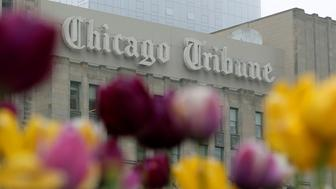 Flowers are seen outside the Chicago Tribune building in Chicago, Illinois, United States, May 11, 2016.     REUTERS/Jim Young