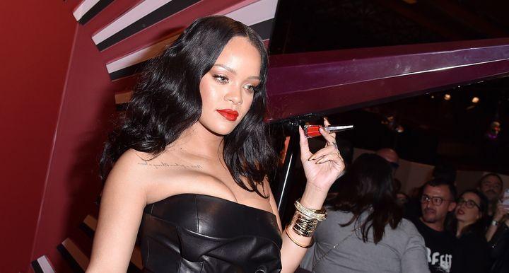 Rihanna holding up her Stunna lip paint.