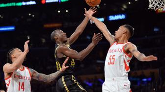April 10, 2018; Los Angeles, CA, USA; Los Angeles Lakers guard Andre Ingram (20) moves to the basket against Houston Rockets guard Tim Quarterman (55) and guard Gerald Green (14) during the second half  at Staples Center. Mandatory Credit: Gary A. Vasquez-USA TODAY Sports