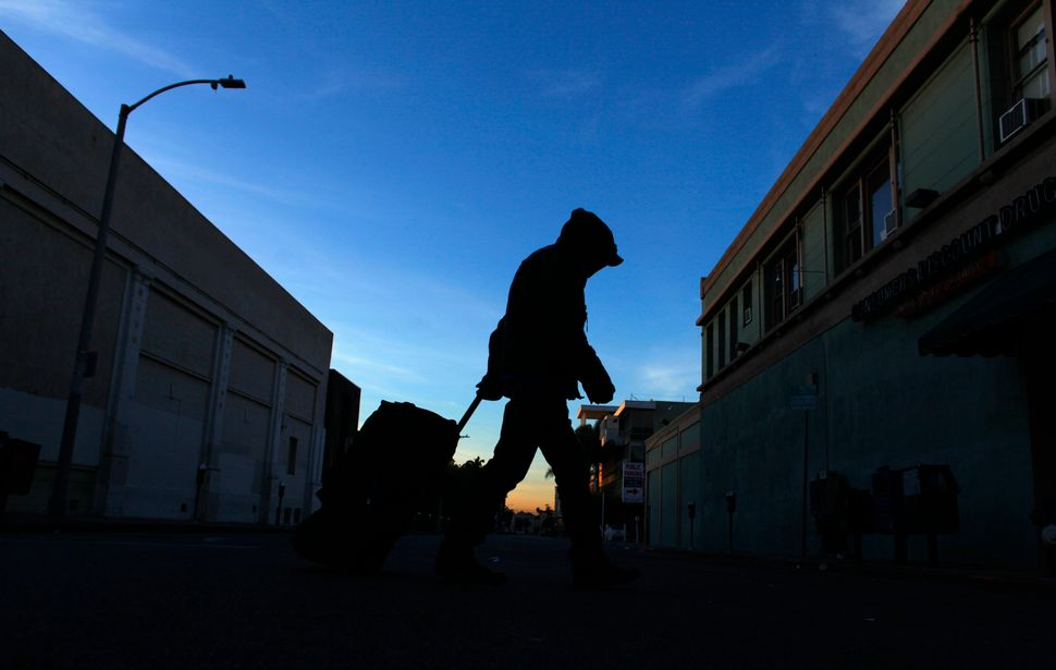 A homeless person makes his way down Los Angeles' Hollywood Boulevard one morning in February 2012.