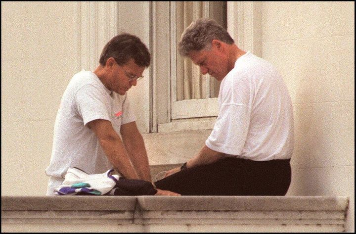 President Bill Clinton prays with Bill Hybels on the North Portico of the White House after a morning jog on June 6, 1995.
