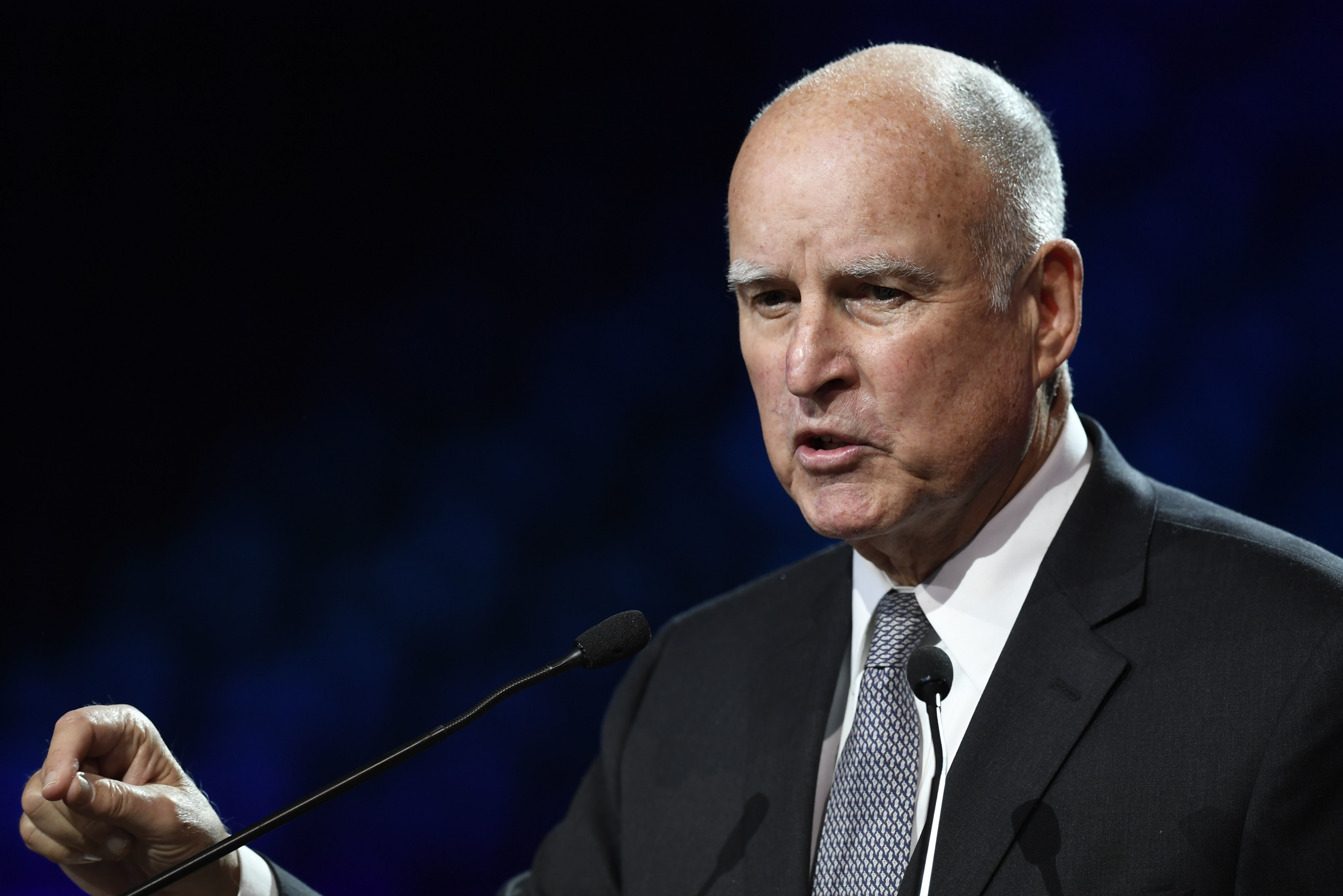 Governor of California Jerry Brown speaks during a panel conference at the One Planet Summit on December 12, 2017, at La Seine Musicale venue on l'ile Seguin in Boulogne-Billancourt, west of Paris. ?The French President hosts 50 world leaders for the 'One Planet Summit', hoping to jump-start the transition to a greener economy two years after the historic Paris agreement to limit climate change. / AFP PHOTO / Eric FEFERBERG        (Photo credit should read ERIC FEFERBERG/AFP/Getty Images)