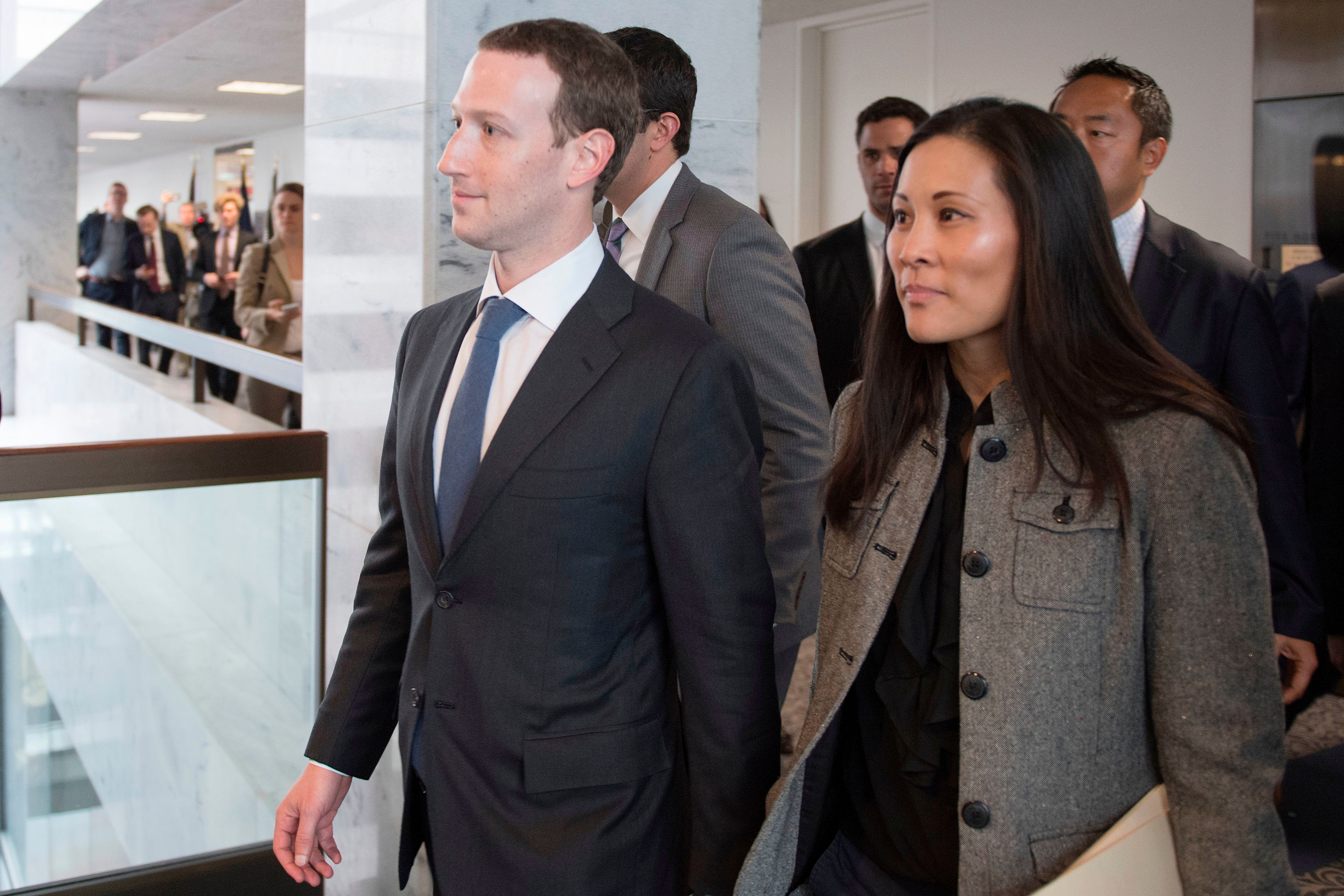 Mark Zuckerberg and Andrea Besmehn, Mark Zuckerbergs executive assistant at Facebook depart US Senator Bill Nelson's, D-Florida, office on Capitol Hill in Washington, DC, on April 9, 2018. Embattled Facebook chief Mark Zuckerberg has placed the blame for security lapses at the world's largest social network squarely on himself as he girded Monday for appearances this week before angry lawmakers.In prepared remarks released by a congressional panel, Zuckerberg admitted he was too idealistic and failed to grasp how the platform -- used by two billion people -- could be abused and manipulated.  / AFP PHOTO / JIM WATSON / The erroneous mention[s] appearing in the metadata of this photo by JIM WATSON has been modified in AFP systems in the following manner: [Andrea Besmehn (R), Mark Zuckerbergs executive assistant at Facebook] instead of [Priscilla Chan]. Please immediately remove the erroneous mention[s] from all your online services and delete it (them) from your servers. If you have been authorized by AFP to distribute it (them) to third parties, please ensure that the same actions are carried out by them. Failure to promptly comply with these instructions will entail liability on your part for any continued or post notification usage. Therefore we thank you very much for all your attention and prompt action. We are sorry for the inconvenience this notification may cause and remain at your disposal for any further information you may require.        (Photo credit should read JIM WATSON/AFP/Getty Images)