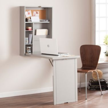 This table folds up and down, and can be used as either a desk or a dining table. It's ideal for super-small spaces without m