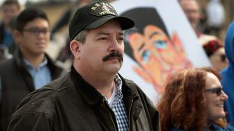 JANESVILLE, WI - MARCH 28:  Randy Bryce joins other residents at a rally to show support for students who finished the last leg of a 50-mile march through Wisconsin in the hometown of House Speaker Paul Ryan (R-WI) to call attention to gun violence on March 28, 2018 in Janesville, Wisconsin. About 40 students from around Wisconsin participated in the march, dubbed 50 Miles More, to keep alive the spirit and dialog of the recent March For Our Lives events. Bryce, a union ironworker, is challenging Speaker Ryan in Wisconsin's 1st district.  (Photo by Scott Olson/Getty Images)