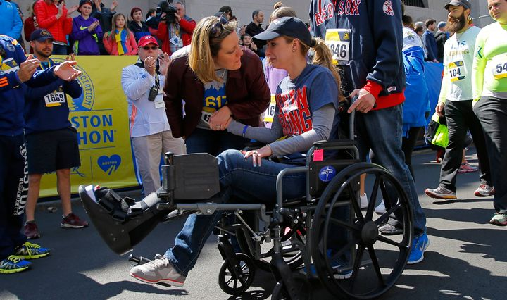 Gregory crosses the marathon's finish line in a wheelchair during a 2014 Tribute Run for survivors and first responders in Boston.