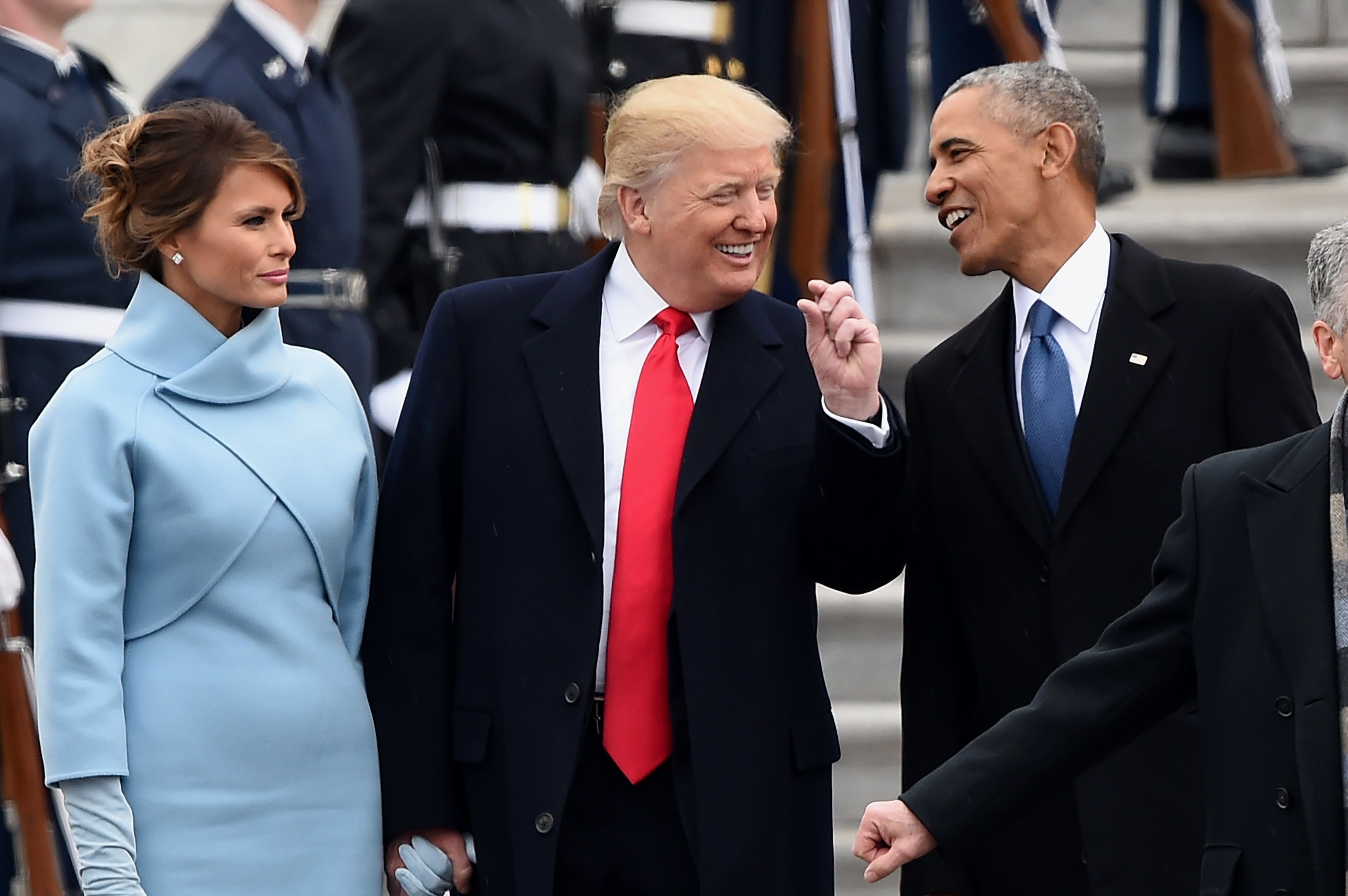 US First Lady Melania Trump looks on as US President Donald Trump and former President Barack Obama talk on the East front steps of the US Capitol after inauguration ceremonies on January 20, 2017 in Washington, DC.  / AFP / Robyn BECK        (Photo credit should read ROBYN BECK/AFP/Getty Images)