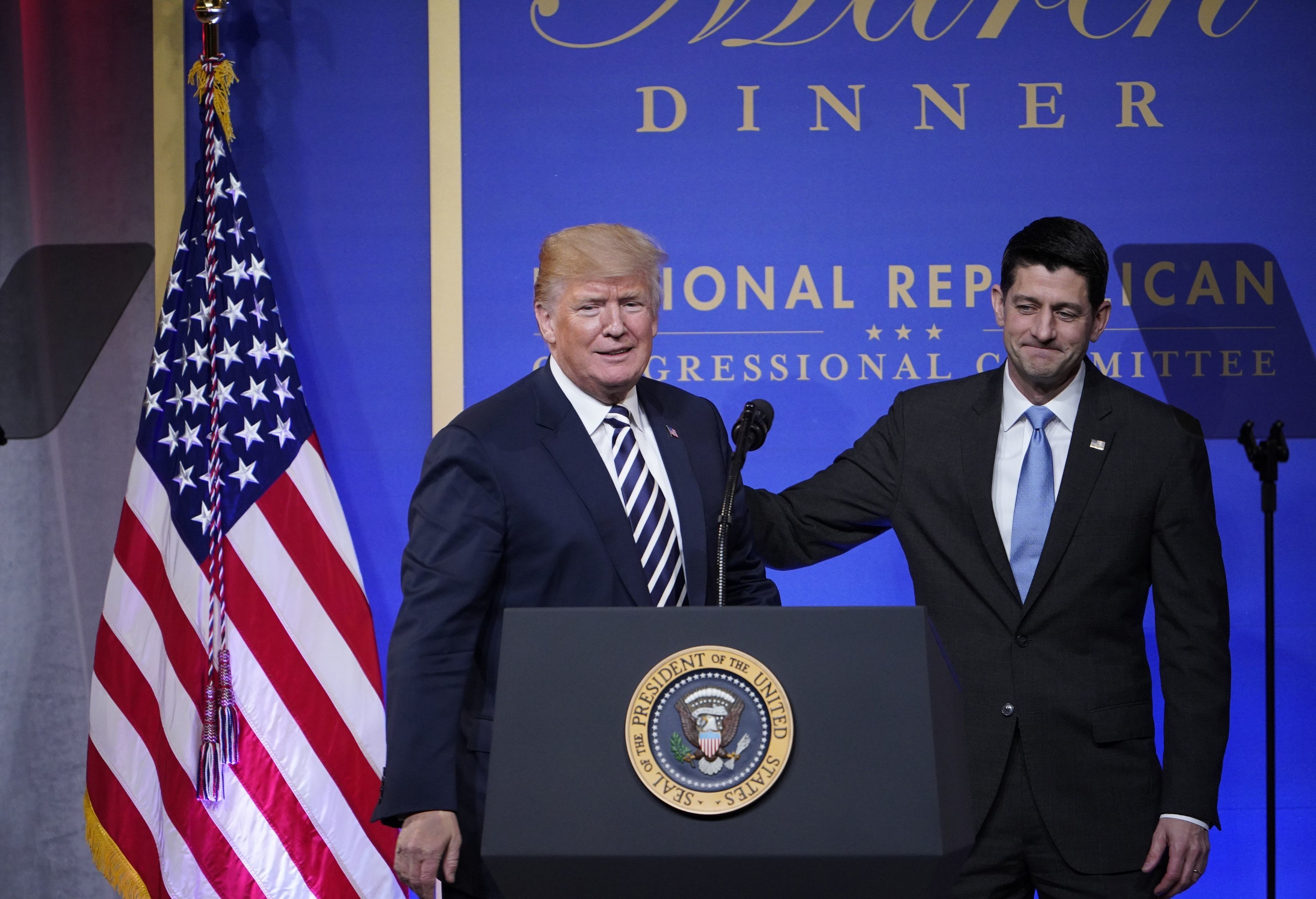 US President Donald Trump greets US Speaker of the House Paul Ryan during the National Republican Congressional Committee March Dinner at the National Building Museum on March 20, 2018 in Washington, DC. / AFP PHOTO / MANDEL NGAN        (Photo credit should read MANDEL NGAN/AFP/Getty Images)