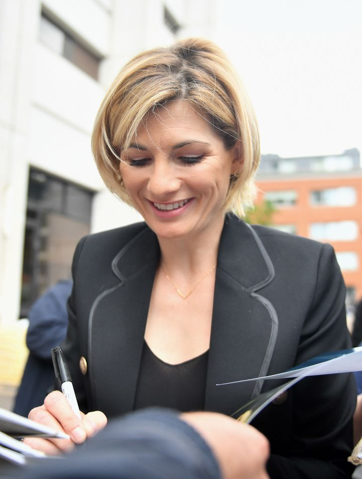 "New ""Doctor Who"" star Jodie Whittaker signing autographs."