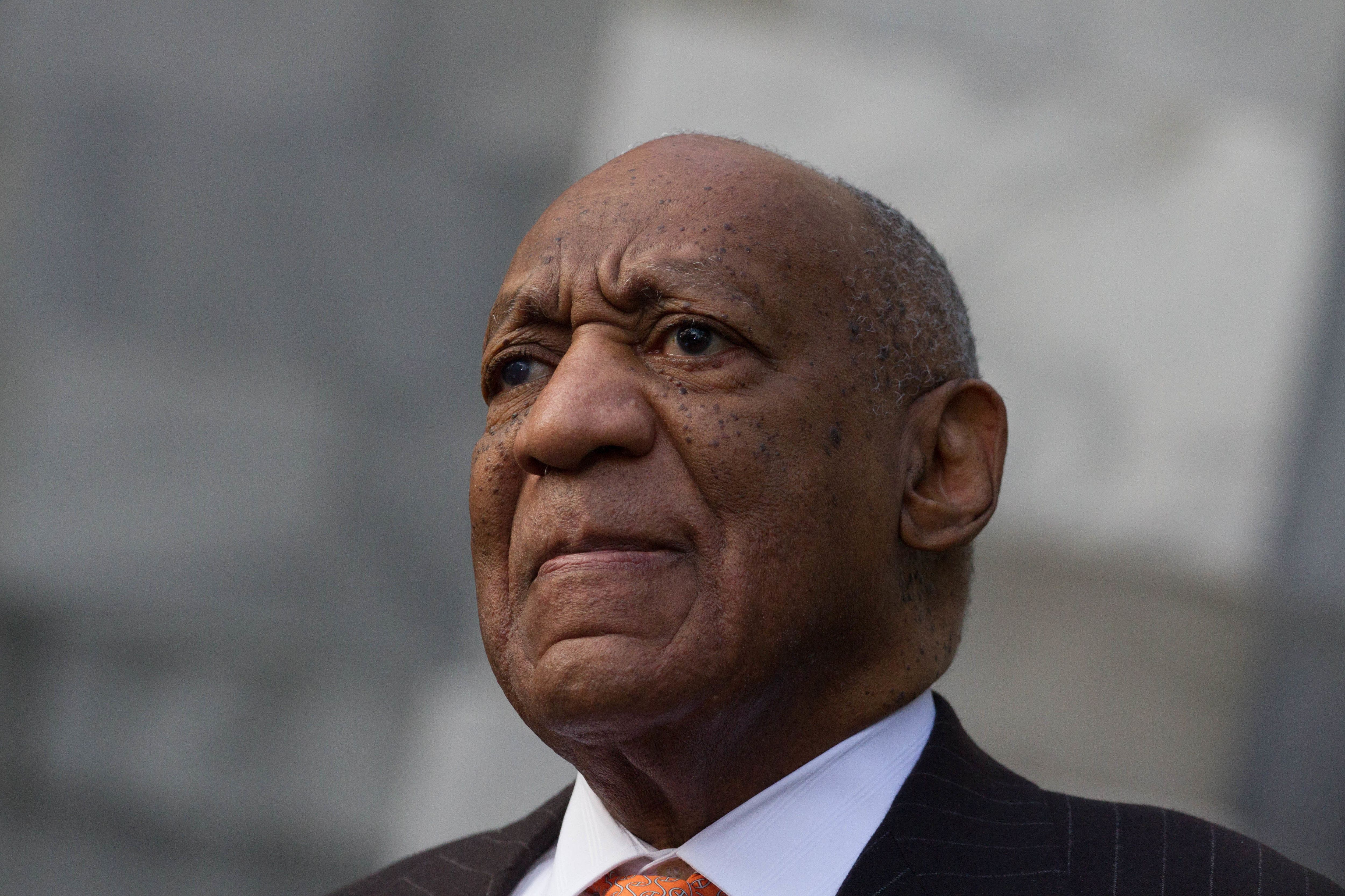 NORRISTOWN, PA, UNITED STATES - 2018/04/10: Actor Bill Cosby stands as spokesman Andrew Wyatt addresses the media ahead of day 2 of Cosby's sexual assault re-trial at the Montgomery County Courthouse. (Photo by Michael Candelori/Pacific Press/LightRocket via Getty Images)