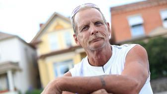 BUTTE, MT - JULY 06: Lifelong Butte resident Randy Scott, 58, stands for a portrait near a residence on which he just completed roofing work in a neighborhood near downtown Butte on July 6, 2017 in Butte, Montana. Butte is home to the toxic Berkeley Pit. Formerly an open pit copper mine, today the Berkeley Pit is part of the largest Superfund site in the United States. In its heyday, in the 1860s, the Butte area was known as the 'Richest Hill on Earth' due to the bonanza in copper and other metals. (Photo by Janie Osborne/Getty Images)