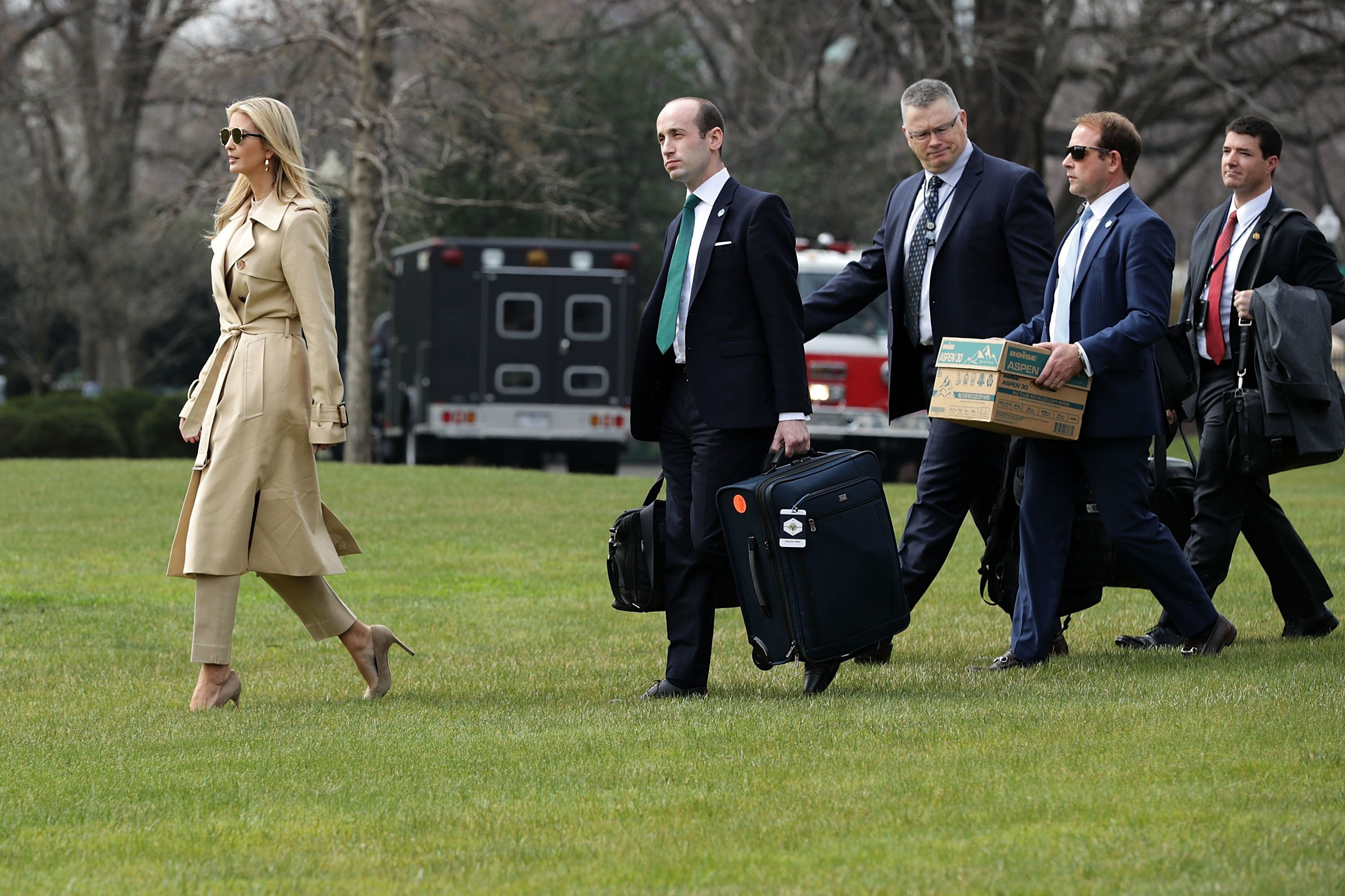 WASHINGTON, DC - MARCH 29:  (L-R)  Ivanka Trump, White House Senior Advisor Stephen Miller, Deputy National Security Advisor Ricky Waddell and Deputy Director of Presidential Advance Jordan Karem walk across the South Lawn before departing the White House with U.S. President Donald Trump March 29, 2018 in Washington, DC. President Trump is traveling to Ohio to deliver a speech on infrastructure before continuing on to Palm Beach for the Easter holiday weekend.  (Photo by Chip Somodevilla/Getty Images)