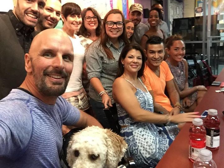 Dave Fortier (far left), who co-founded the nonprofit One World Strong, meets with survivors of the Pulse nightclub shooting