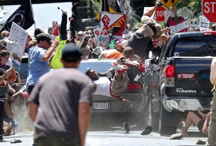 A vehicle drives into a group of protesters demonstrating against a white nationalist rally in Charlottesville, Virginia