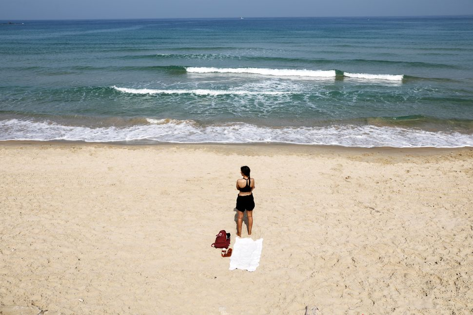 A beachgoer stands still in Tel Aviv.