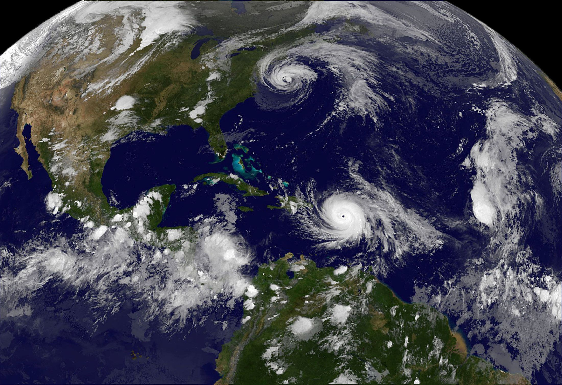 Hurricane Maria which bore down menacingly on the Virgin Islands and Puerto Rico on Tuesday after devastating the tiny island nation of Dominica and Hurricane Jose (top) are both seen in the Atlantic Ocean in this NOAA's GOES East satellite image taken at 21:45 p.m. EDT on September 19, 2017 (0145 UTC, September 20, 2017).     Courtesy NASA/NOAA GOES Project/Handout via REUTERS  ATTENTION EDITORS - THIS IMAGE WAS PROVIDED BY A THIRD PARTY.