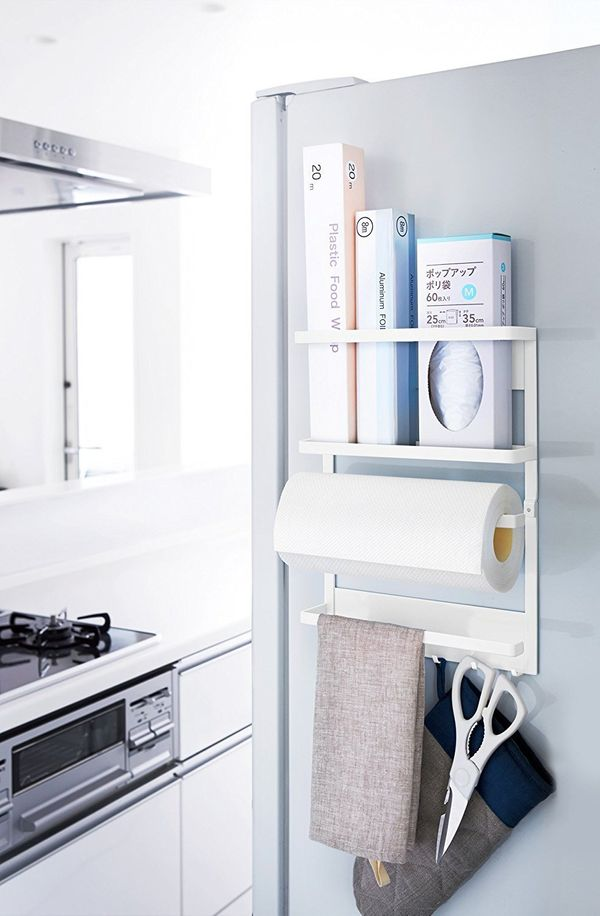If you have limited wall and counter space, this magnetic rack will store all of your essentials: paper towels, hand towels,