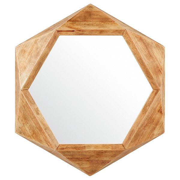 This mirror is versatile enough to hang anywhere, though we're loving the idea of it above a tiny entryway table. Get it <a h