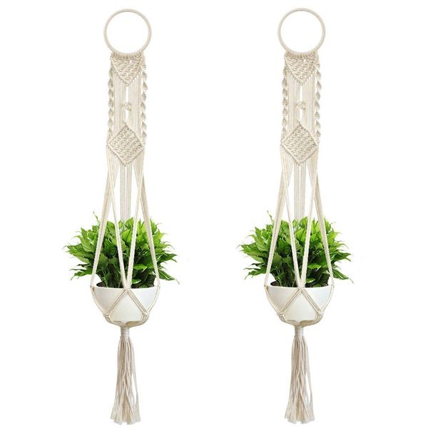 Add some greenery and some unique fabrics and textures to your space with this two-pack of macrame plant hangers. Get them <a