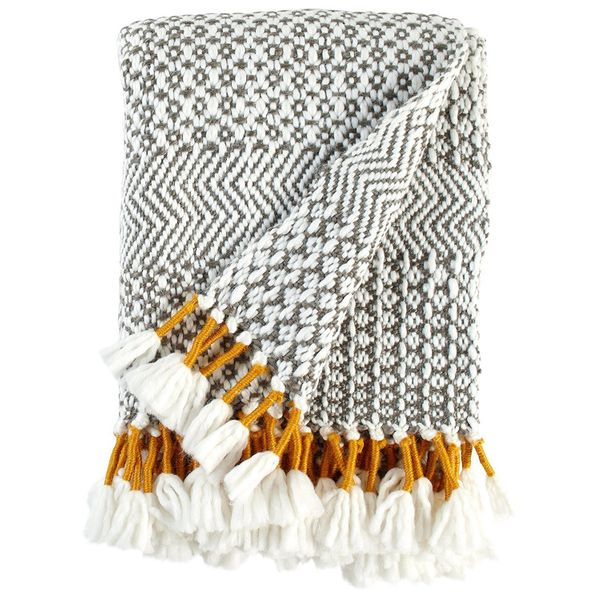 "A cozy blanket that'll add a hint of color to any room. Get it <a href=""https://www.amazon.com/dp/B075X5GNLG/ref=st"
