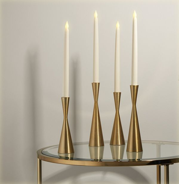 These hourglass-shaped candlesticks have the look of a bygone era. Place them on a bookshelf, dining table or even in a windo