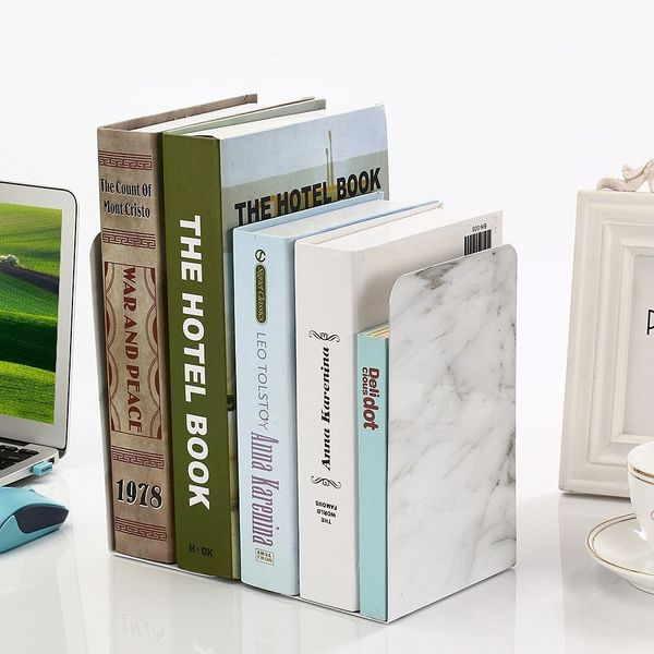 "These sleek bookends are both functional, beautiful and practical. Get them <a href=""https://www.amazon.com/Umiko-Bookends-No"