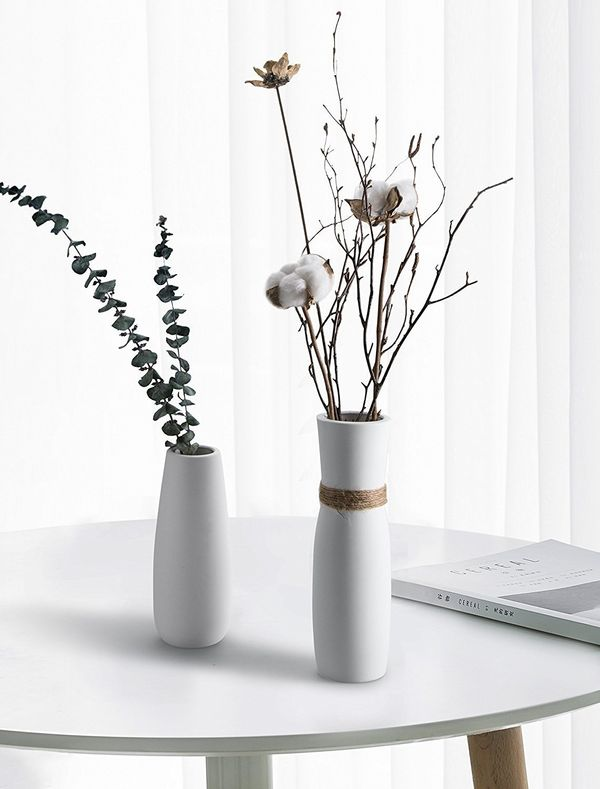 These minimalist vases do what they should. That is, they draw attention to the beautiful flowers they hold, rather than to t