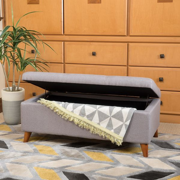 "This ottoman bench will store all of your essentials easily, like board games, linens, pillows, and more. Get it <a href=""htt"