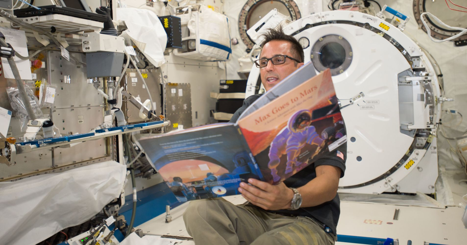 astronauts in space reading books - photo #2