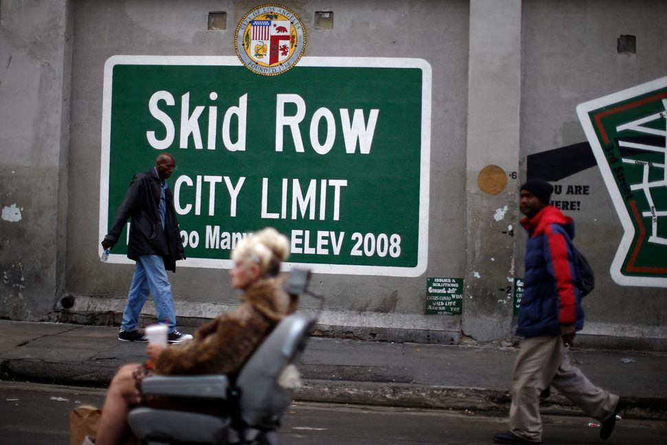 People view a memorial for a man killed by police in the Skid Row neighborhood of Los Angeles, March 2, 2015.