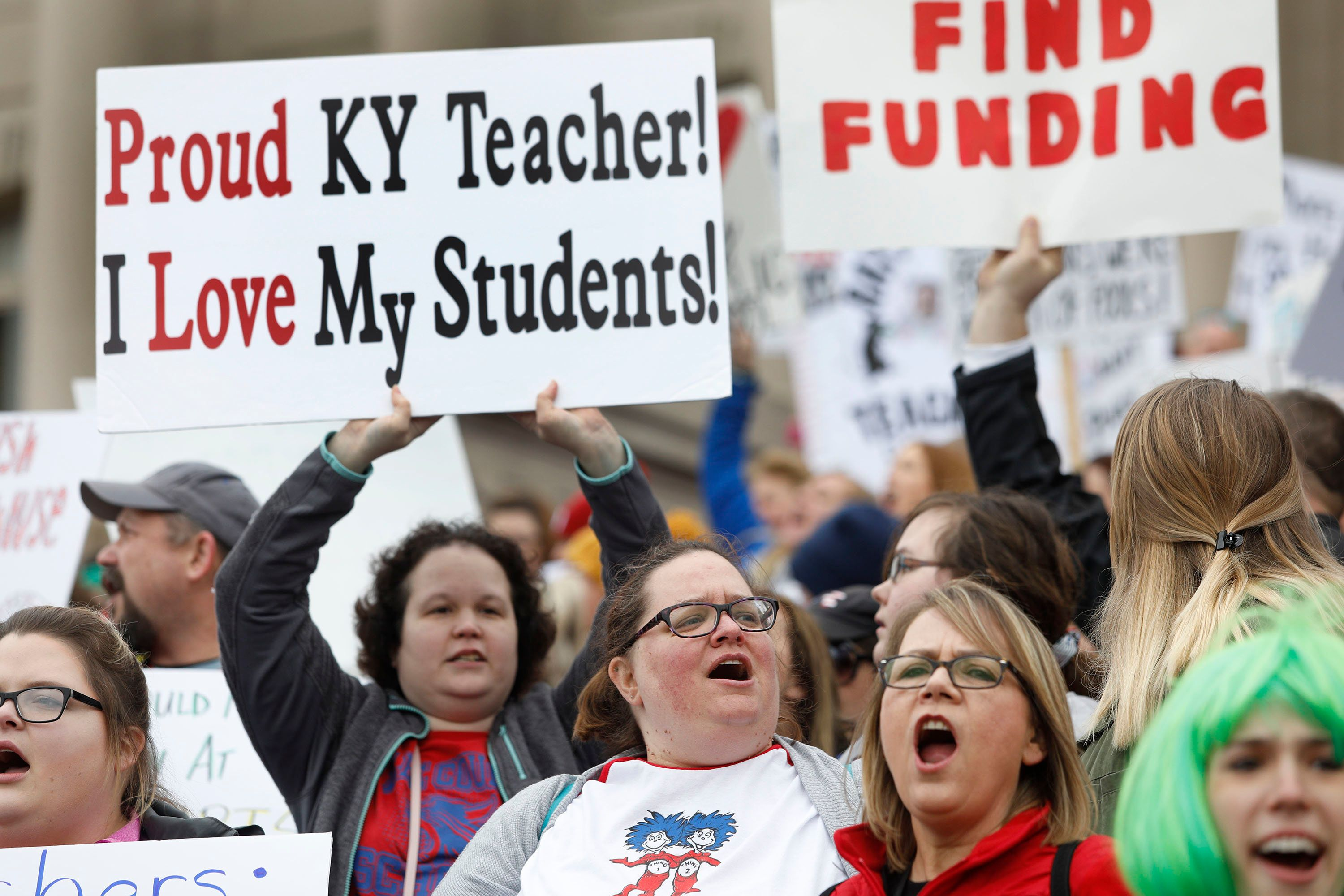 FRANKFORT, KY - APRIL 2: Public school teachers and their supporters protest against a pension reform bill at the Kentucky State Capitol April 2, 2018 in Frankfort, Kentucky. The teachers are calling for higher wages and are demanding that Kentucky Gov. Matt Bevin veto a bill that overhauls their pension plan. (Photo by Bill Pugliano/Getty Images)