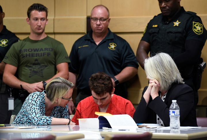 Nikolas Cruz sits with attorneys Melisa McNeill (left) and Diane Cuddihy (right), appointed by the Broward Public Defender's