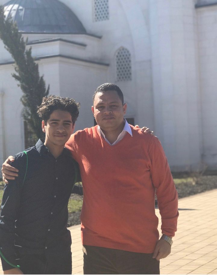 Yusef Haddabah (left) poses with his teacher Ahmed Abdelbasit on a school field trip.