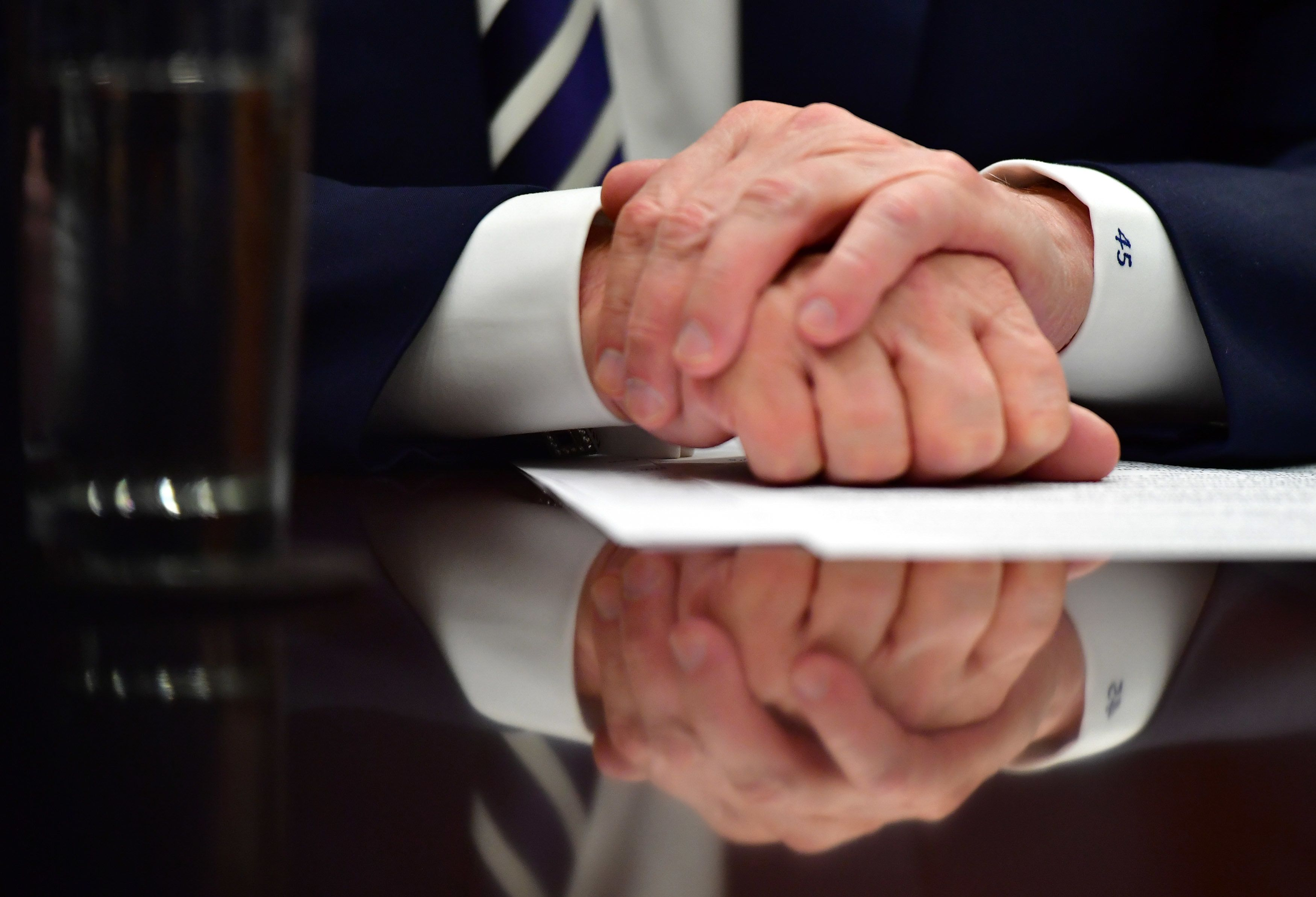 WASHINGTON, DC - MARCH 20:   President Donald Trump's hands are seen as he holds a law enforcement roundtable on sanctuary cities, in the Roosevelt Room at the White House on March 20, 2018 in Washington, D.C. (Photo by Kevin Dietsch-Pool/Getty Images)