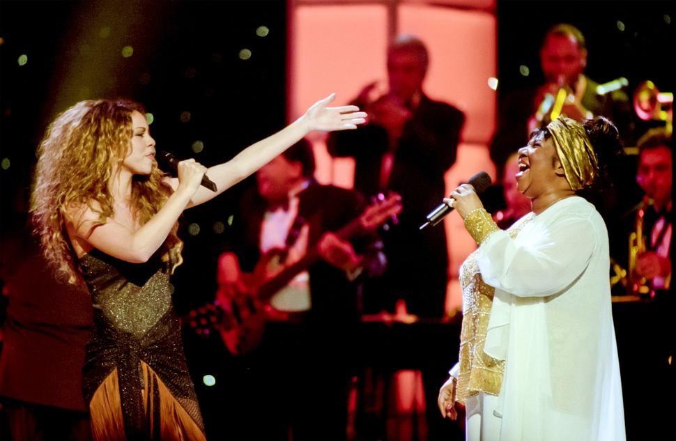 "Mariah Carey and Aretha Franklin at ""Divas Live."""