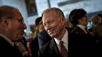 Scooter Libby, former Vice President Dick Cheney's former Chief of Staff, mingles before a ceremony to unveil a marble bust of Cheney in the US Capitol in Wshington, December 3, 2015. REUTERS/James Lawler Duggan