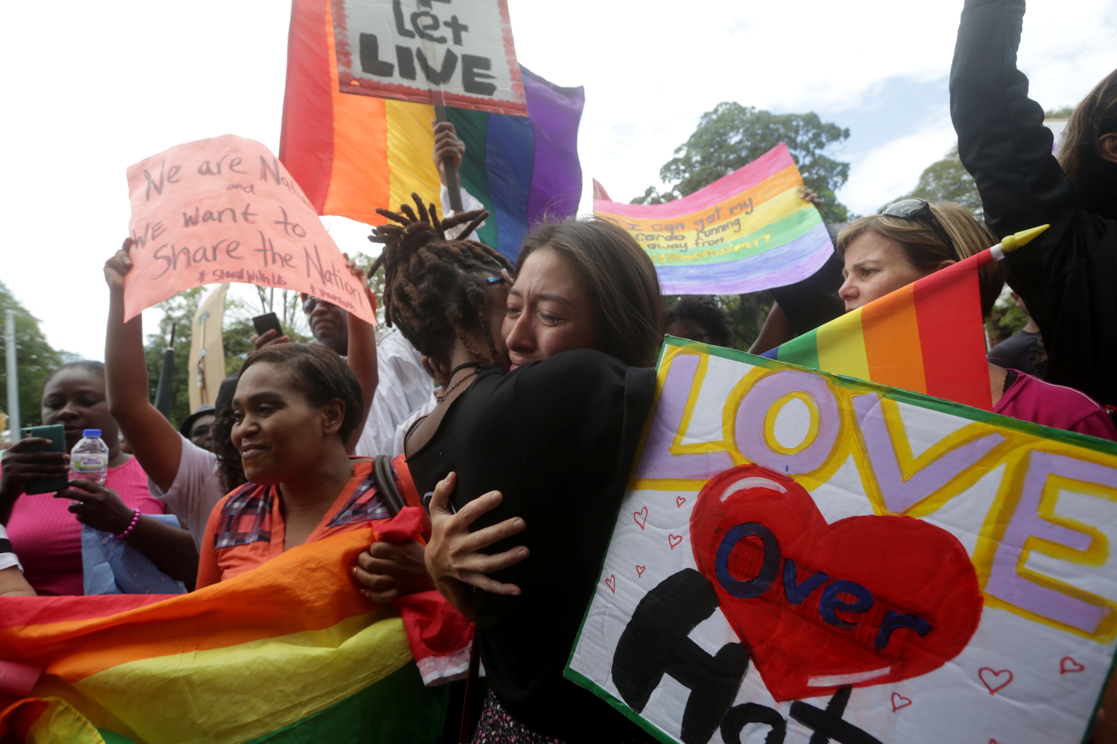 Members of the LGBT community demonstrate outside the Hall of Justice in Port-of-Spain, Trinidad and Tobago April 12, 2018.  REUTERS/Andrea de Silva