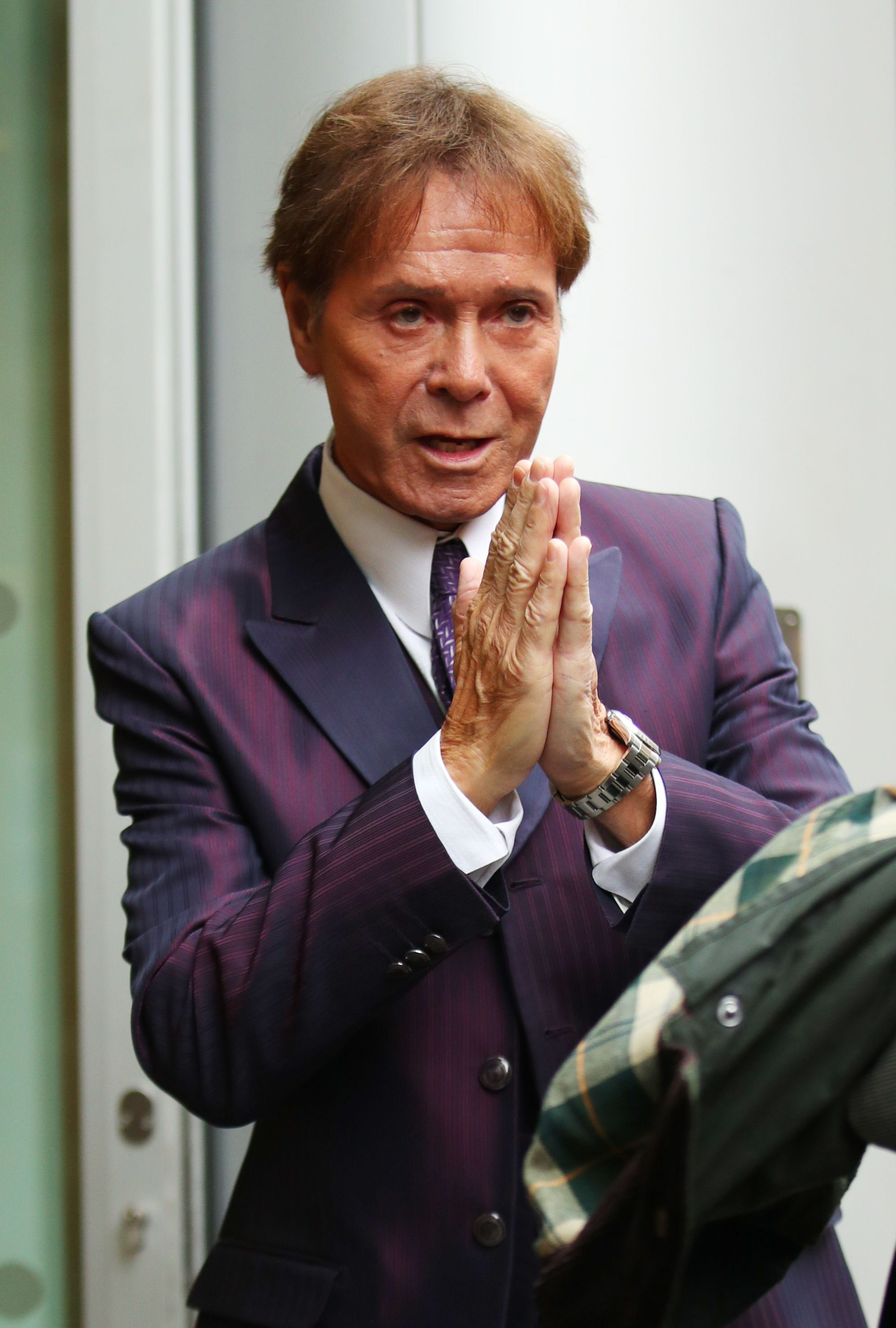 Sir Cliff Richard arrives at the Rolls Building in
