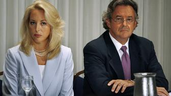 WASHINGTON - JULY 14:  Retired CIA employee Valerie Plame Wilson (L) and her husband, diplomat Joe Wilson, hold a press conference where they announced a lawsuit against senior members of the Bush Administration at the National Press Club July 14, 2006 in Washington, DC. Plame filed suit in U.S. District Court July 13, 2006, charging that Vice President Dick Cheney, his aide, I Lewis 'Scooter' Libby, and presidential advisor Karl Rove destroyed her career when they leaked her identity to the press.  (Photo by Chip Somodevilla/Getty Images)
