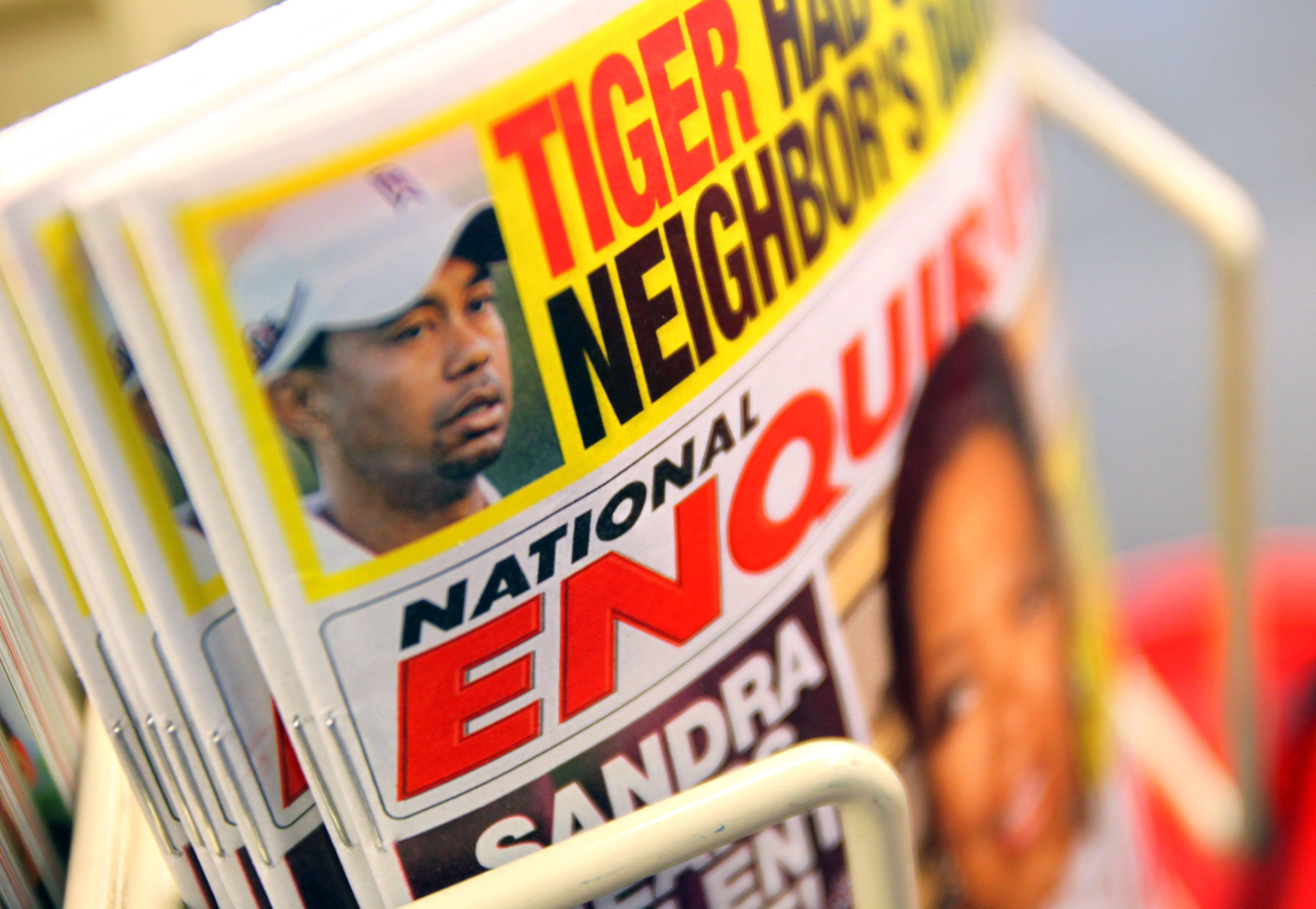 National Enquirer tabloid newspapers are displayed in a store in Chicago, Illinois, U.S., on Monday, April 12, 2010. The runup to the Pulitzer Prize awards was rife with speculation that the National Enquirer could win a Pulitzer for revealing that former Democratic presidential candidate John Edwards had an affair, but the tabloid ended up not winning. Photographer: Tim Boyle/Bloomberg via Getty Images