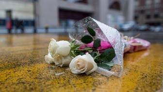 BOSTON, MA - APRIL 08: Flowers placed on the Boston Marathon finish line on Boylston St. on April 8, 2015 in Boston, Massachusetts. Dzhokhar Tsarnaev, 21, was found guilty on all 30 counts related to his involvement in the 2013 bombing, which resulted in three deaths and over 250 injuries. (Photo by Scott Eisen/Getty Images)