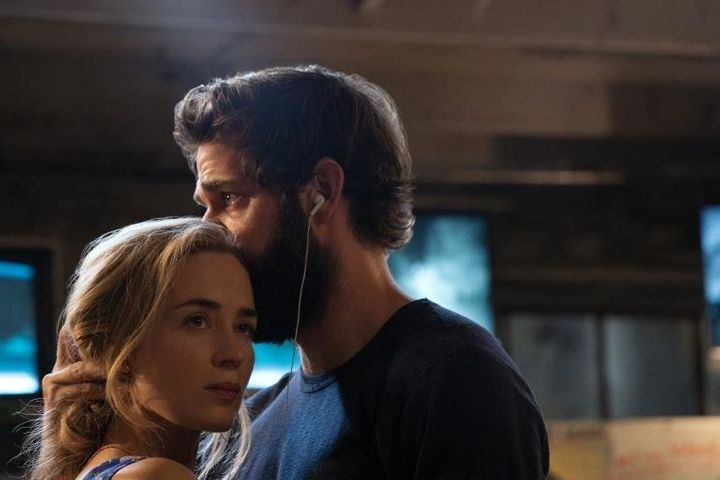 "Evelyn Abbott (Emily Blunt) and Lee Abbott (John Krasinski) share a dance and headphones in ""A Quiet Place."""