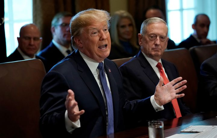 With Secretary of Defense James Mattis at his side, President Donald Trump speaks to his Cabinet on Nov. 1, 2017. A federal judge has blocked Trump's ban on transgender troops in the U.S. military.