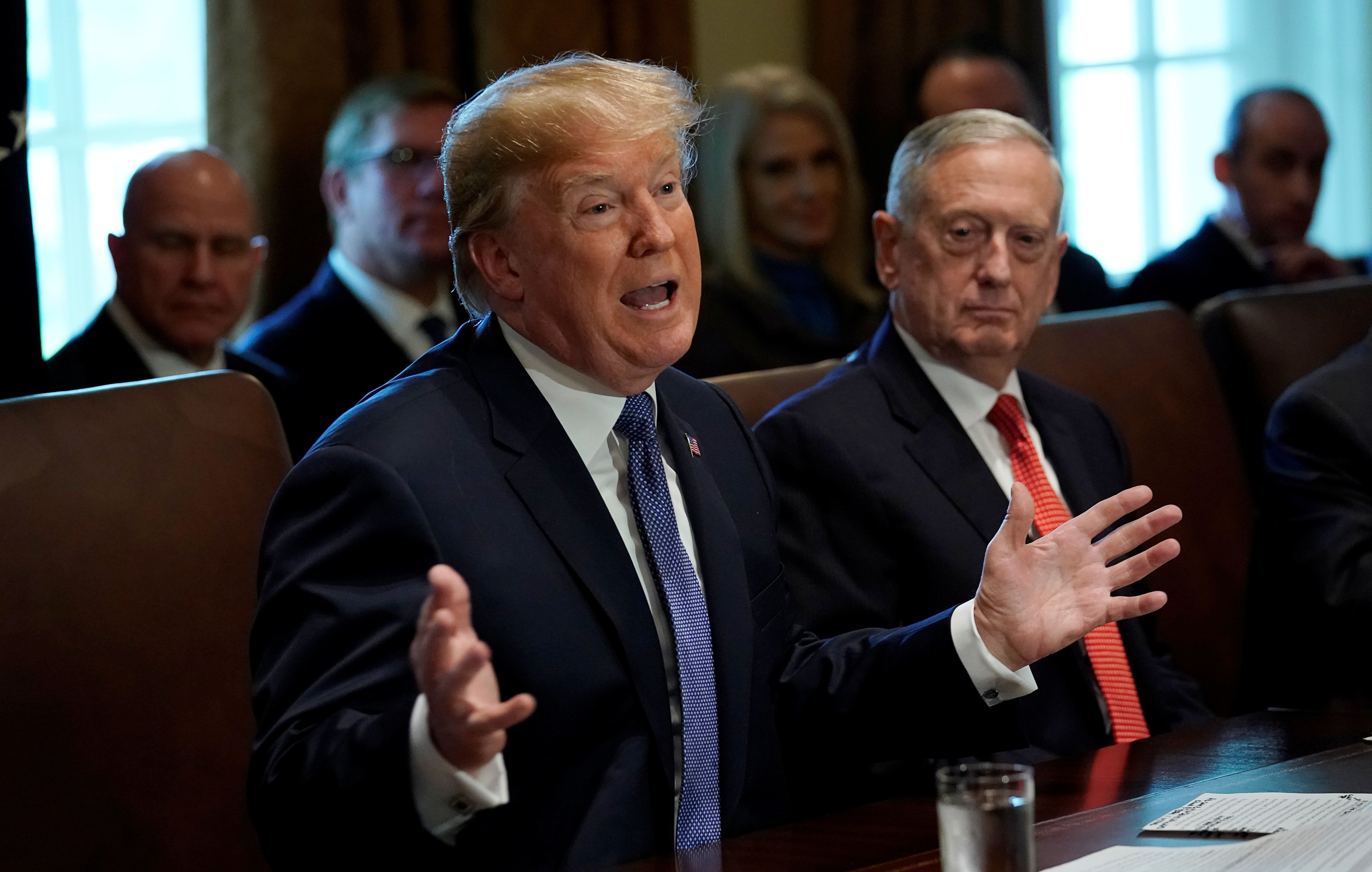 With Secretary of Defense James Mattis at his side, U.S. President Donald Trump speaks during a cabinet meeting at the White House in Washington, U.S., November 1, 2017.  REUTERS/Kevin Lamarque