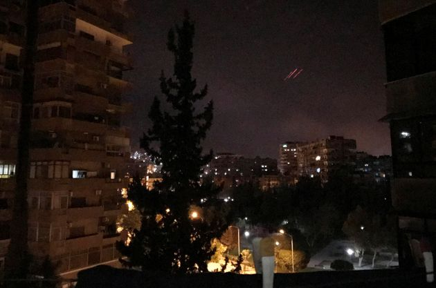 Anti-aircraft fire is seen over Damascus on