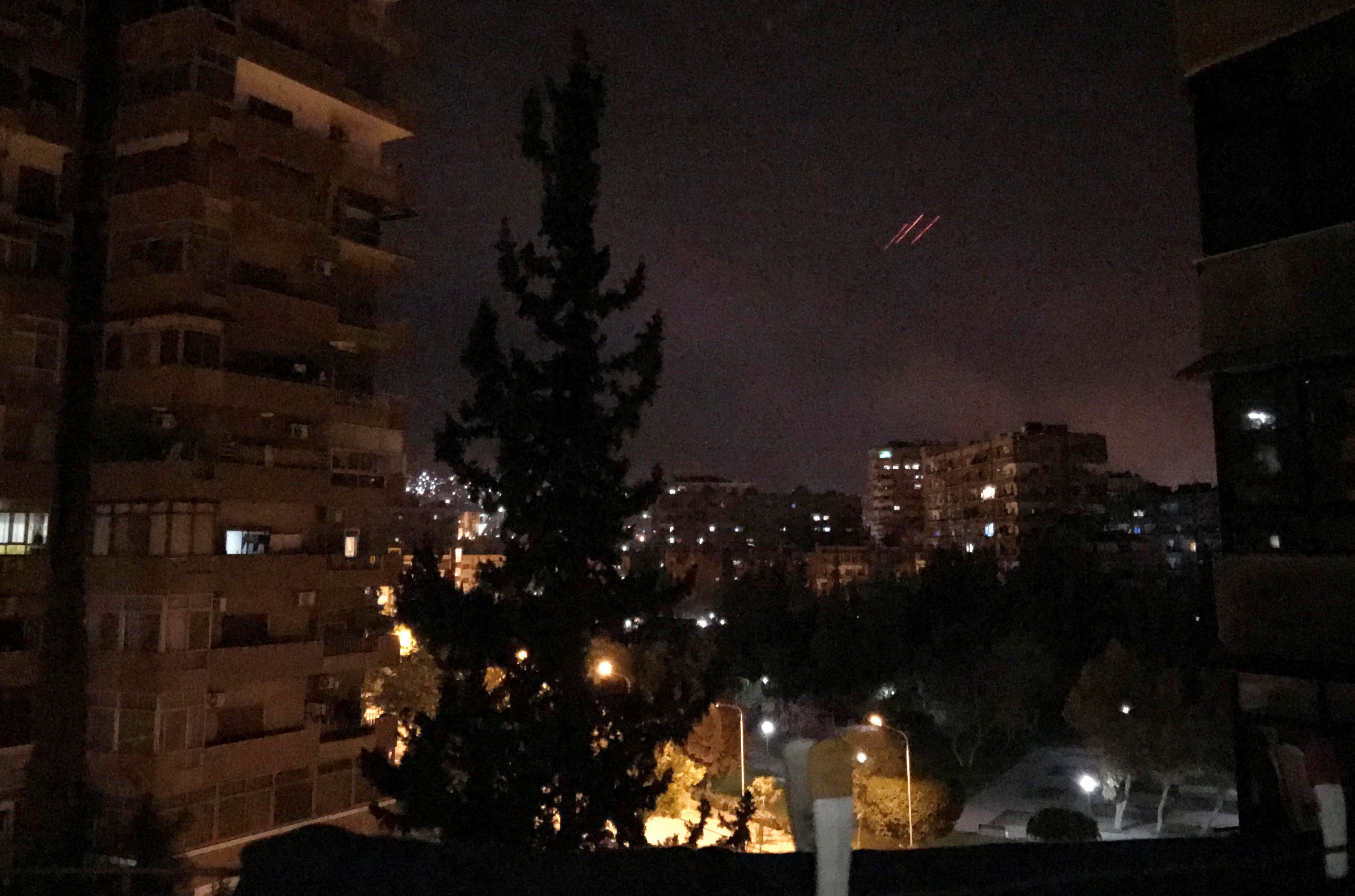 Anti-aircraft fire is seen over Damascus on Saturday.