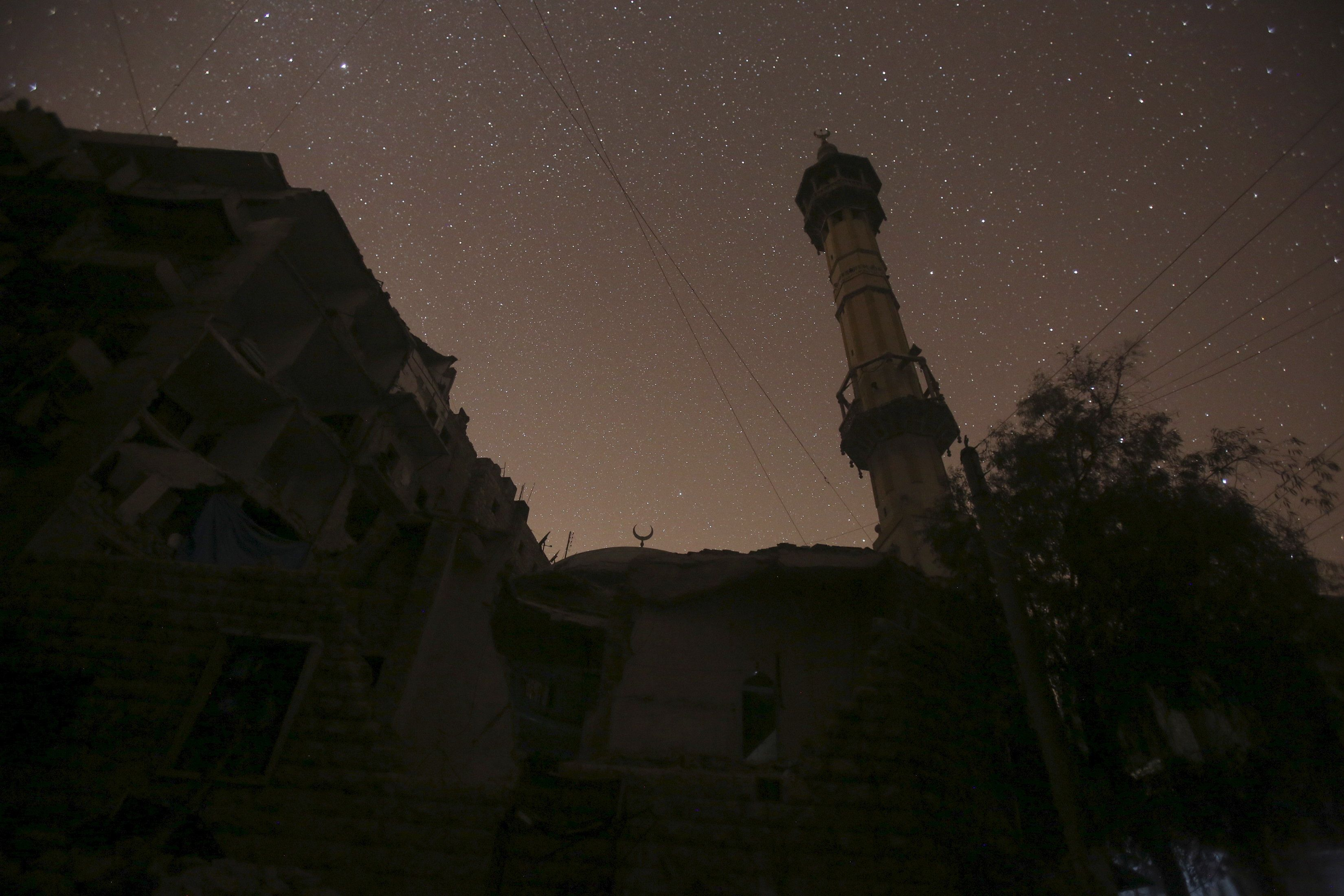 The night sky over a mosque in Aleppo. A huge blast was heard in a government-controlled rural region south of Aleppo on