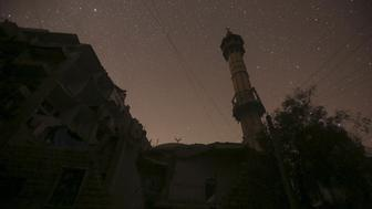 A damaged mosque is pictured at night in Aleppo, Syria December 11, 2015. Picture taken December 11, 2015. REUTERS/Ammar Abdullah